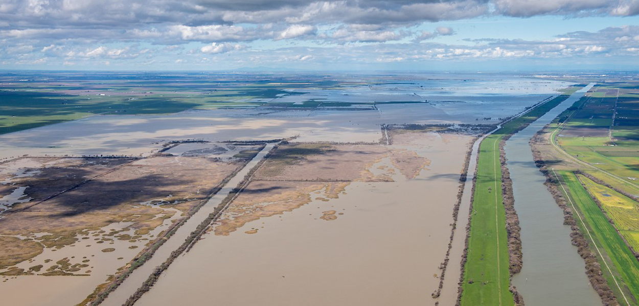 Aerial view of clouds hovering over partially flooded land in the Sacramento-San Joaquin Delta.